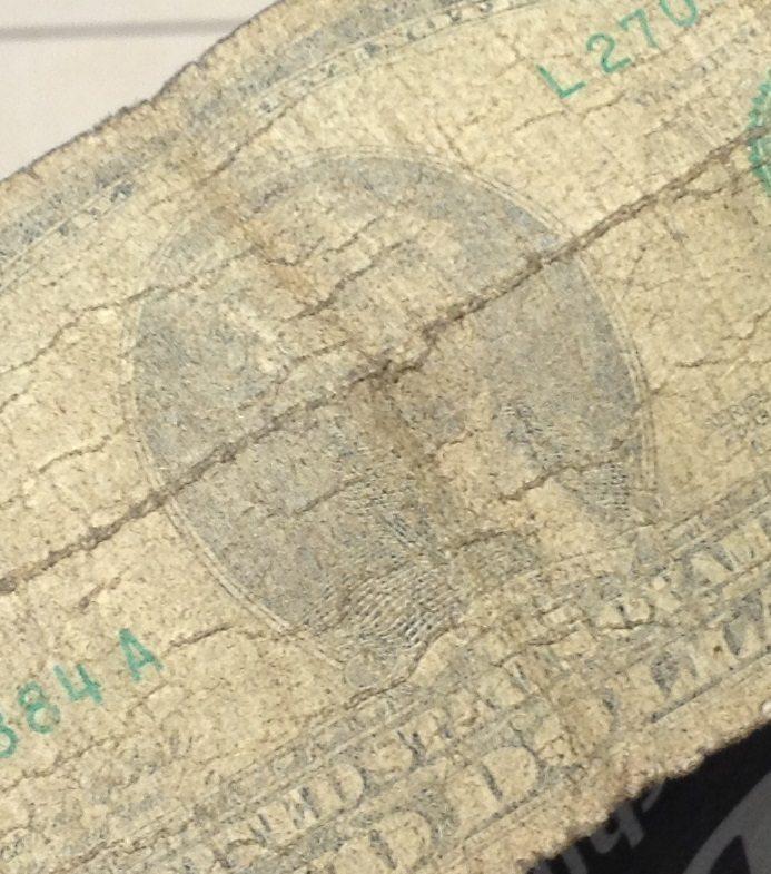 A dollar bill, very faded