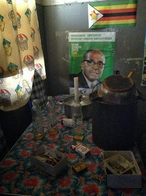 A picture of a hostel interior with Mugabe poster, Mbare, ZImbabwe