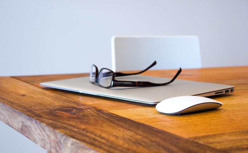 Laptop and glasses by Craig Garner