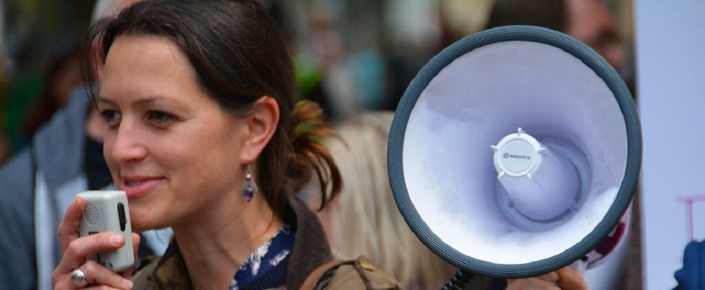 woman with megaphone, speaking, stammering