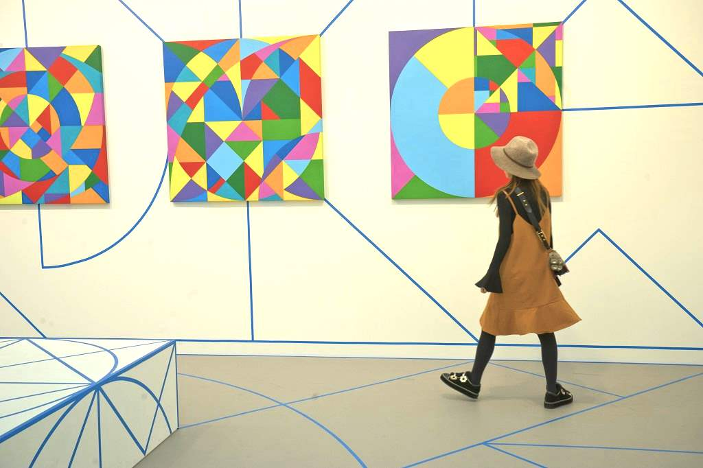 Visitor to the Frieze International Arts Fair at Regent's Park, London,UK